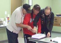 <h2>February Birthday Trio Cutting The Cake 2 </h2><p>Feb. 8, 2009Photography by AwahiliLeft: Nighthawk TroutmanCenter:  Elaine JohnsonRight: Frank Cook<br></p>