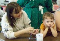 <h2>Necklace Making</h2><p>Photography by AwahiliMay 30, 2009<br></p>