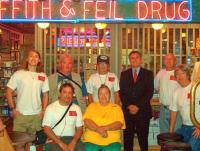 <h2>65. Group Shot At The Drug Store </h2><p>Photography by store employeeJuly 5, 2009Back row, standing, left to right:John Little Hawk Dunn, John Wahiya Weathers,Frank Roaring Thunder Cook,Ric Griffith,Michael Eagle Heart Dunn,Front row, sitting, left to right:Tony Awahili Robles, Penny Cook,Jerry 2 Feather Thornton<br></p>