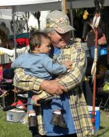<h2>Member of Sky Hawk Drum With Grandchild</h2><p>October 11, 2009Photography by Wahiya<br></p>